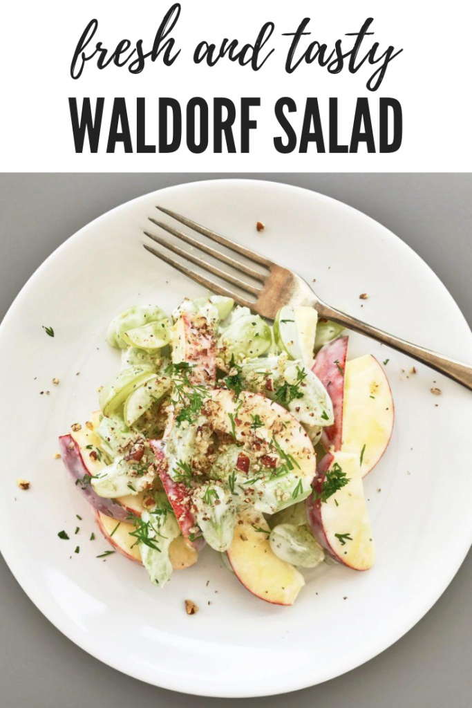 waldorf salad with apples, celery and grapes in a creamy mayonnaise dressing with crushed walnuts and dill