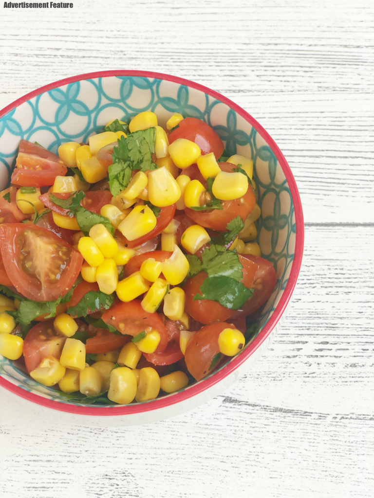 bowlful of homemade Mexican salsa with tinned sweetcorn, chopped tomatoes and coriander