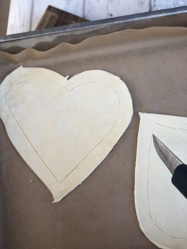 heart shaped puff pastry sheet with indented line a couple of centimetres from the edge of the tart