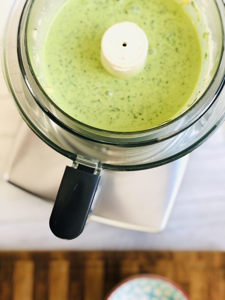 magimix food processor with spinach, banana, kiwi and natural yogurt blitzed to a vivid green smoothie