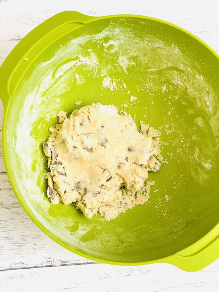 bright green Joseph Joseph mixing bowl filled with Terry's chocolate orange cookie dough