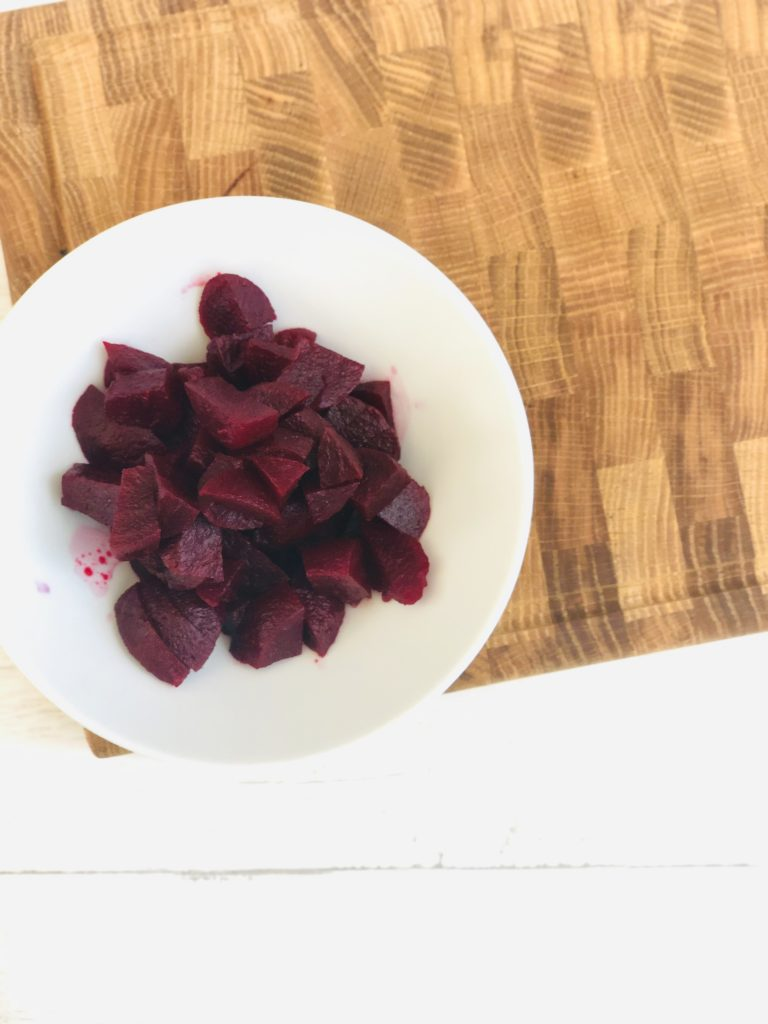white bowl filled with chopped beetroot