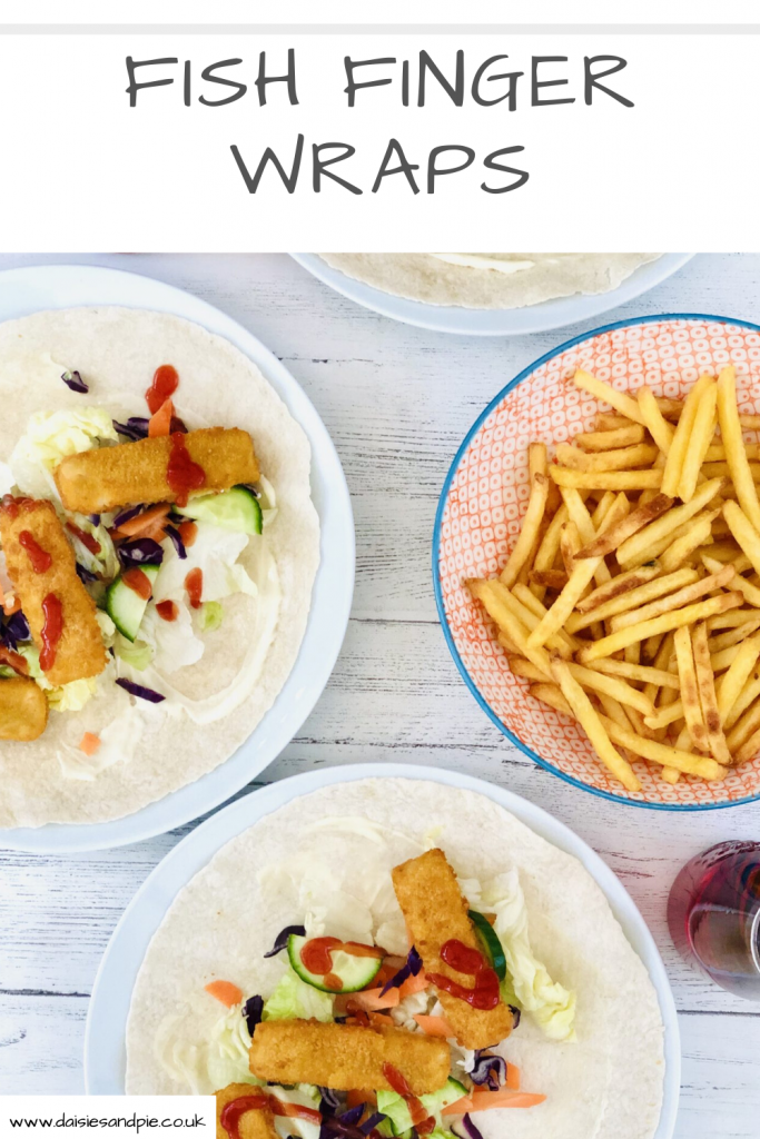 """fish finger wraps with lettuce, cucumber, fish fingers, mayonnaise and drizzle of tomato ketchup, bowl of french fires and bottles of vimto also on the table. Text """"fish finger wraps - www.daisiesandpie.co.uk"""""""
