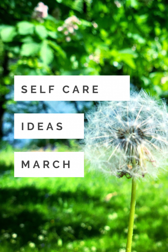 """green grassy field with a one o clock dandelion. Text """"self care ideas March"""""""