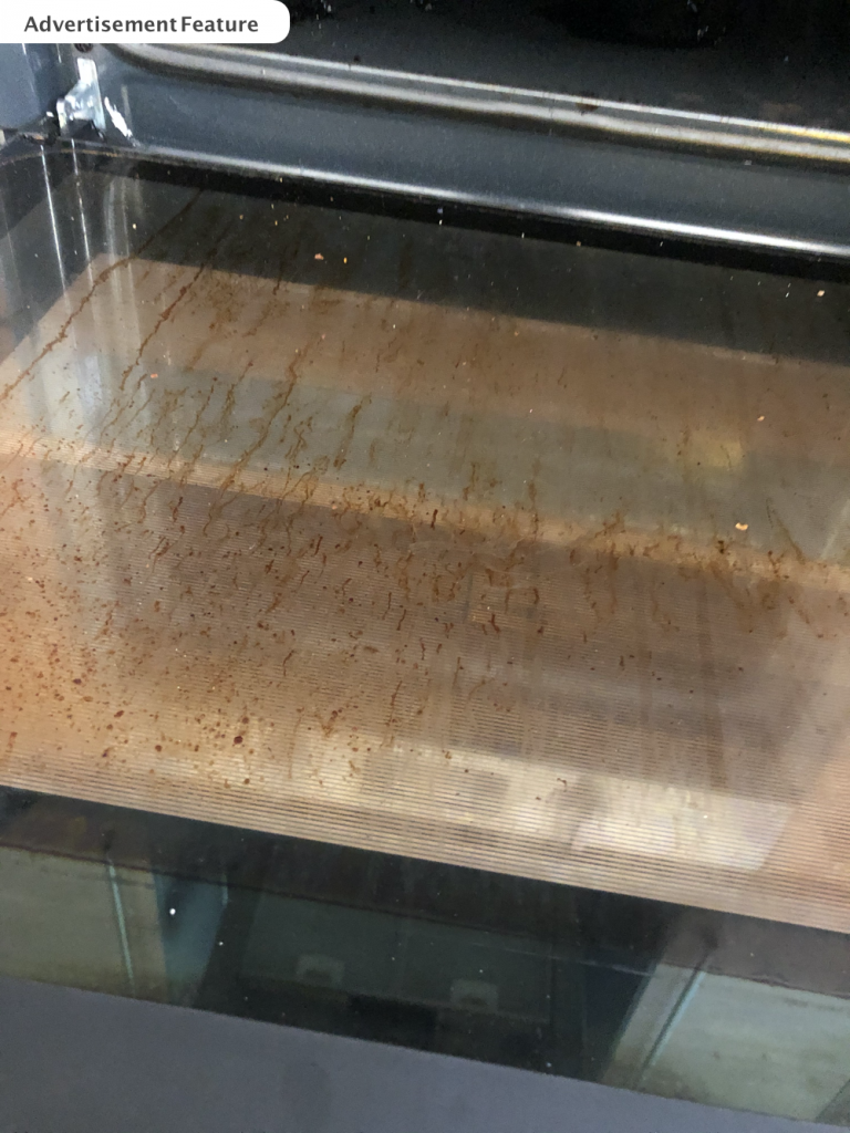 dirty grease splattered oven door glass that needs cleaning