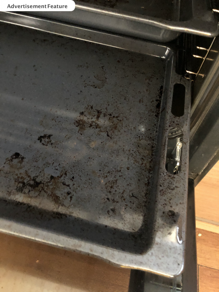 burnt on grease on oven shelf waiting to be cleaned