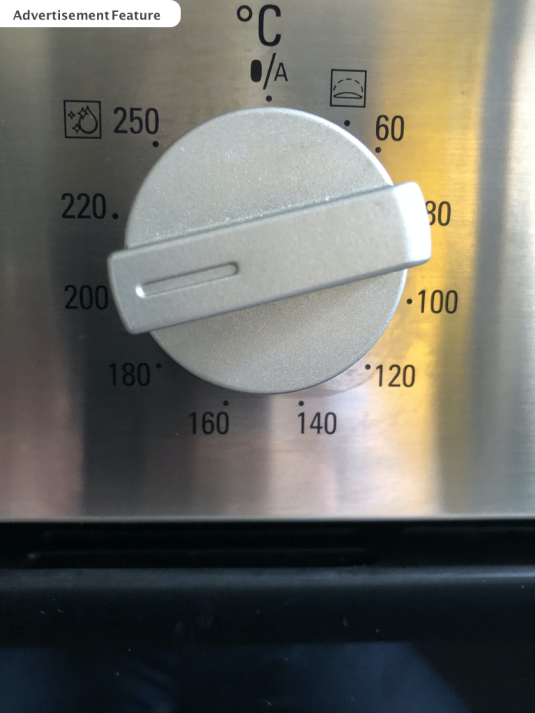 silver coloured oven knob switched to 200 degrees C