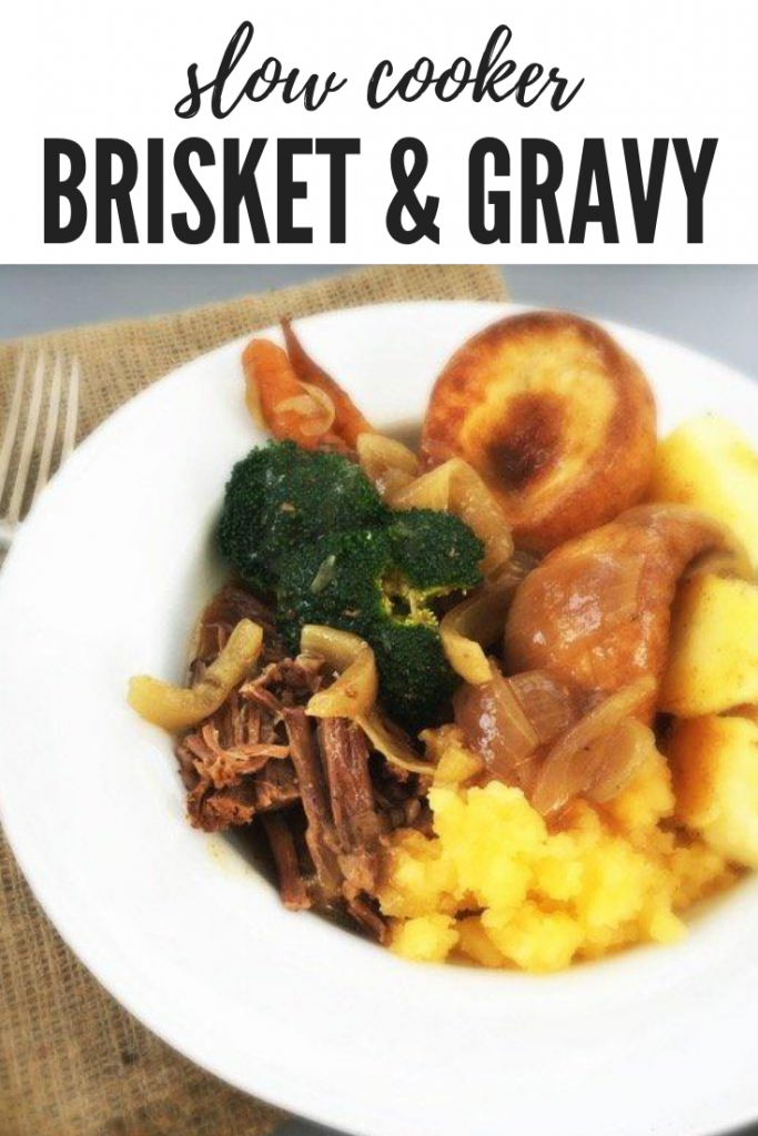 """slow cooker brisket recipe served with roast potatoes, mashed seeded, broccoli, yorkshire pudding. Text overlay """"slow cooker brisket and gravy"""""""