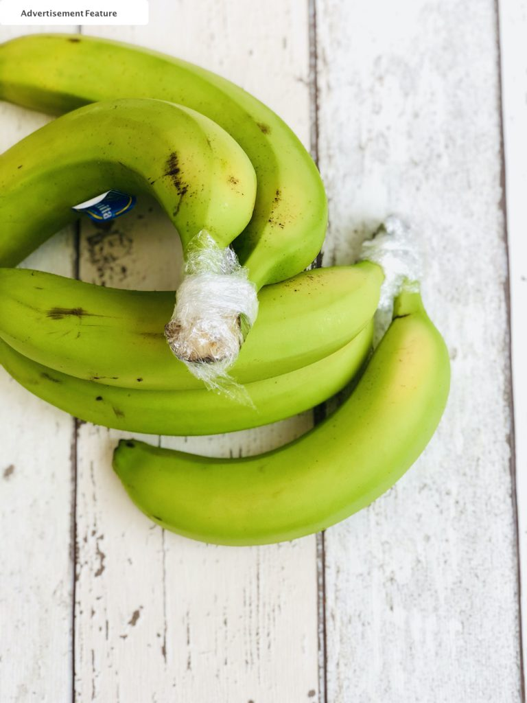 bananas with the stems wrapped with cling film