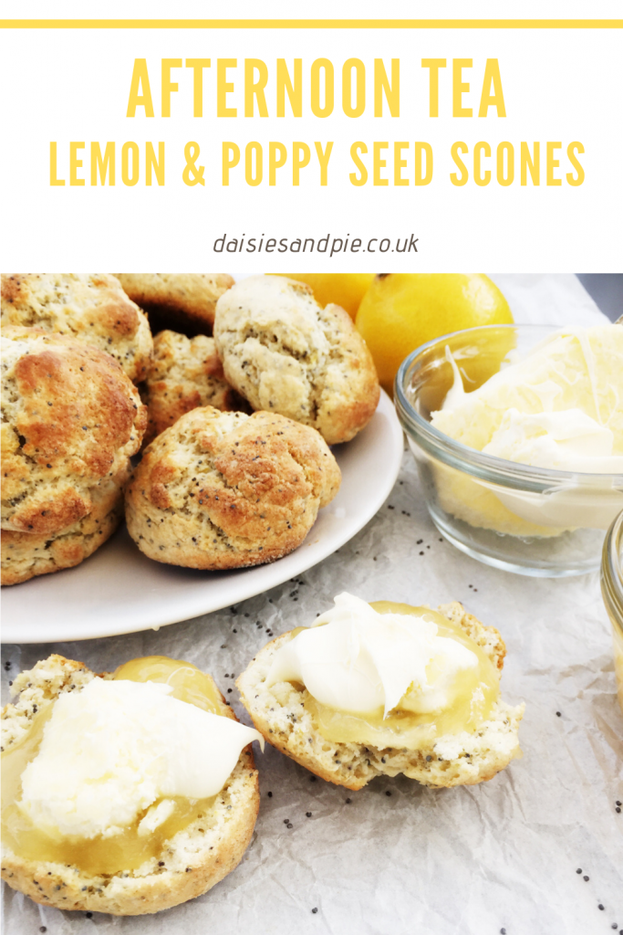 "white plate loaded with lemon and poppy seed scones, some scone split open and spread with lemon curd and clotted cream, small pot of clotted cream and lemon curd to the side. Text ""afternoon tea - lemon and poppy seed scones - daisiesandpie.co.uk"""