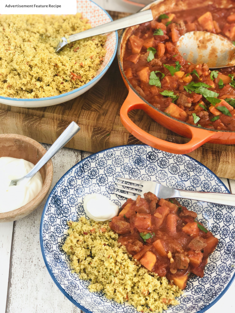 moroccan lamb stew served with couscous and yogurt