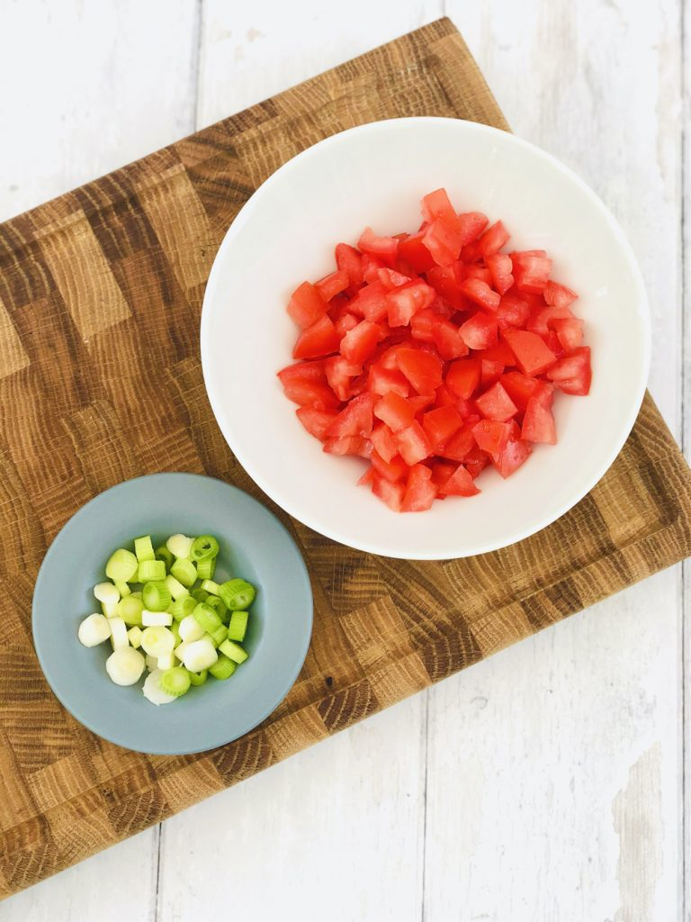 chopped vine tomatoes and spring onions