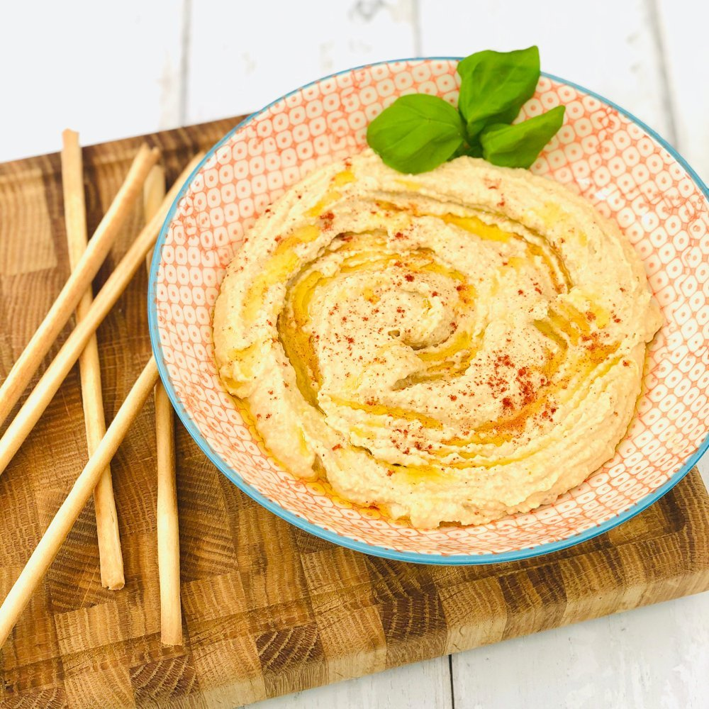 homemade hummus drizzled with olive oil and sprinkled with smoked paprika