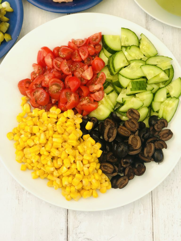 chopped baby plum tomatoes, diced cucumbers, sweetcorn and chopped black olives