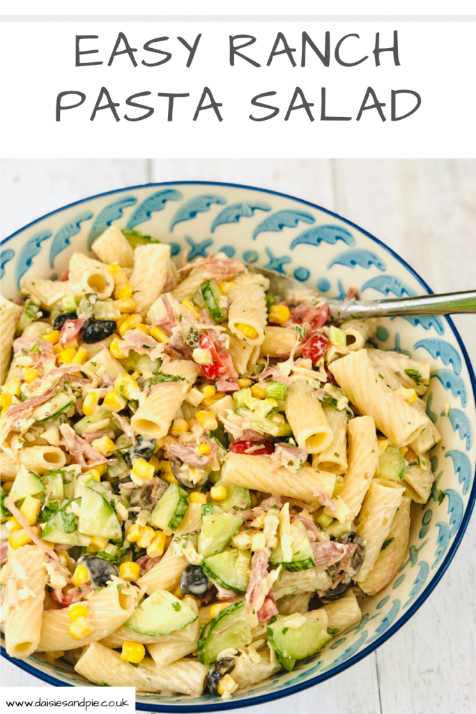 "easy ranch pasta salad in a blue and white serving bowl on a white table. Text ""easy ranch pasta salad"""