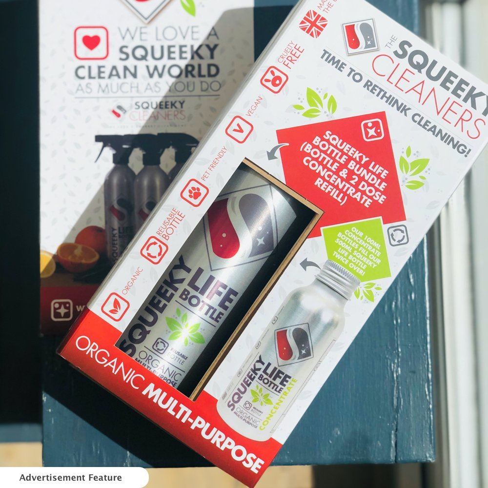 squeeky cleaner eco friendly multi purpose cleaning spray in a box on a grey stool