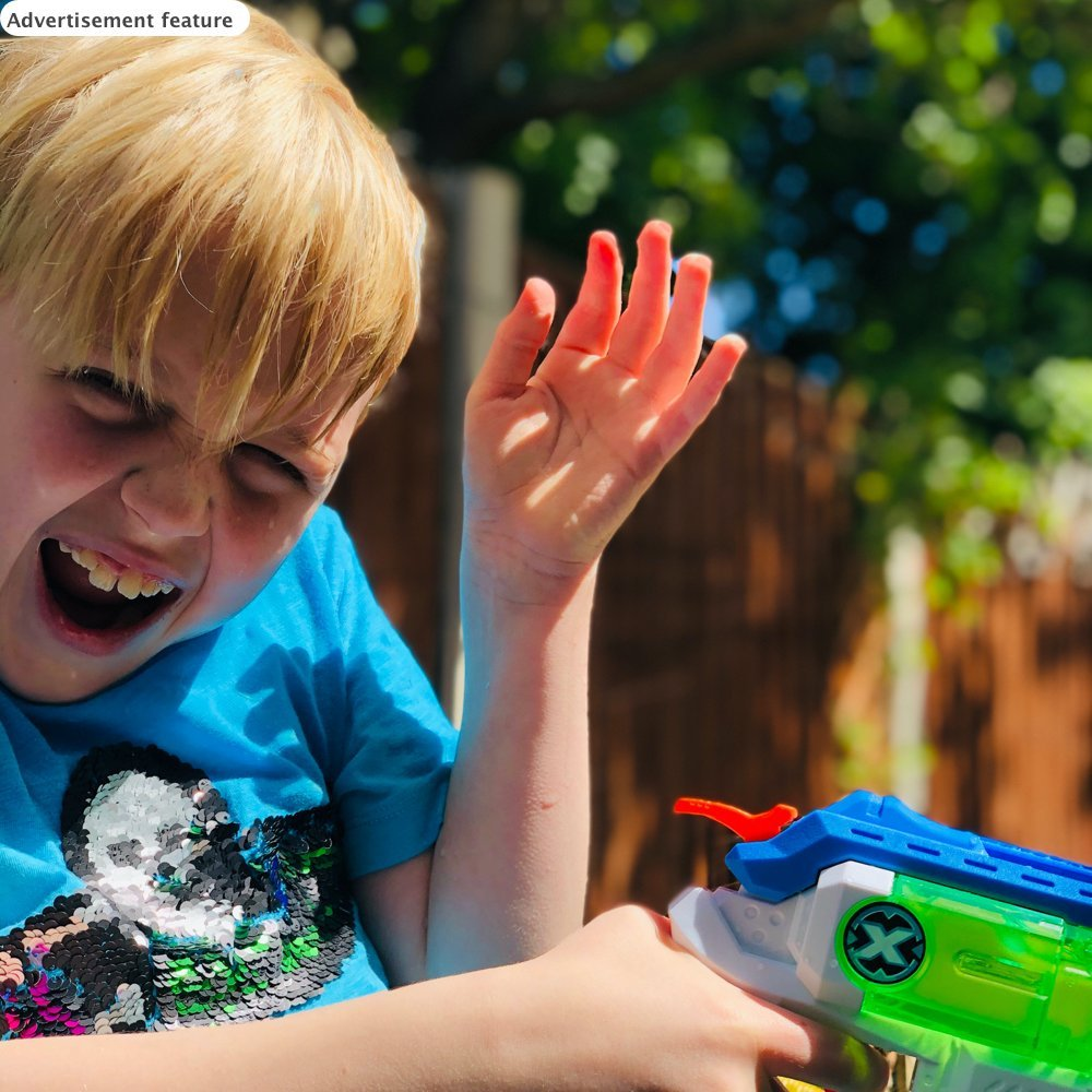 boy being sprayed with water during a water fight