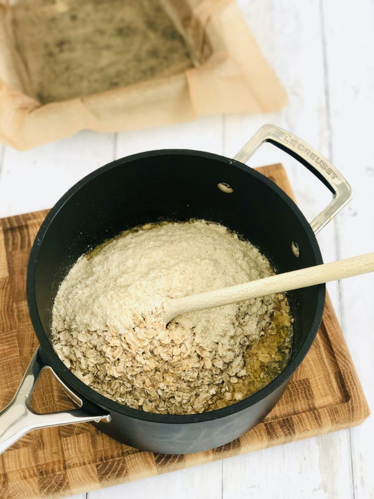 ready brek and oats tipped into a pan of melted butter, brown sugar and syrup