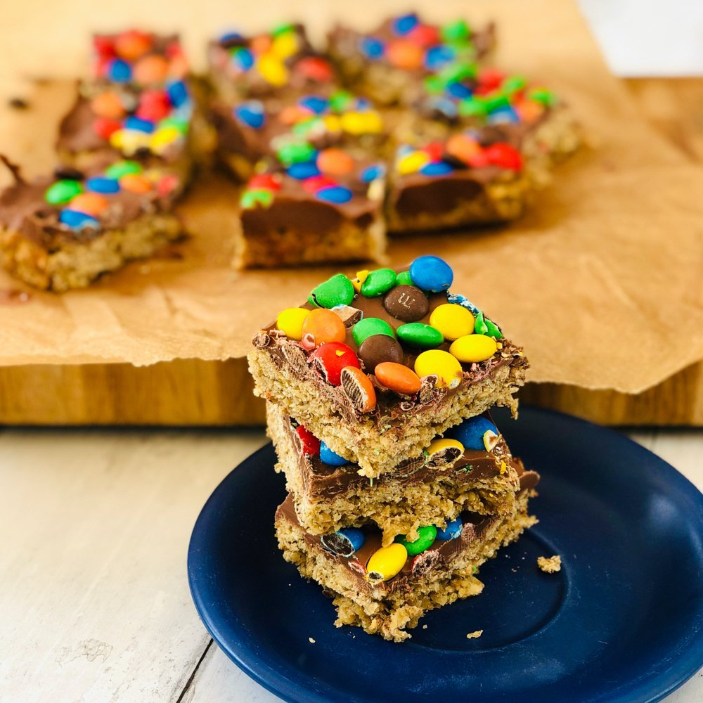 stack of M&M's chocolate flapjacks on a blue plate