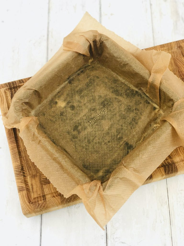 square prestige baking tin lined with brown baking paper