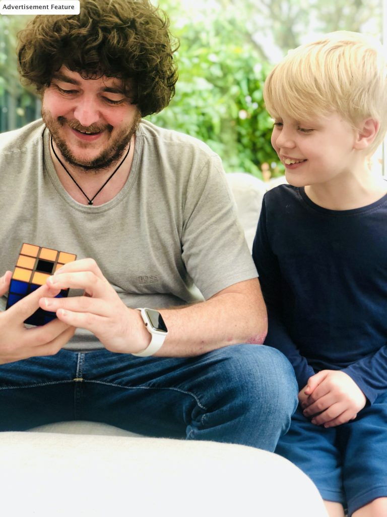 dad and son playing Rubik's revolution