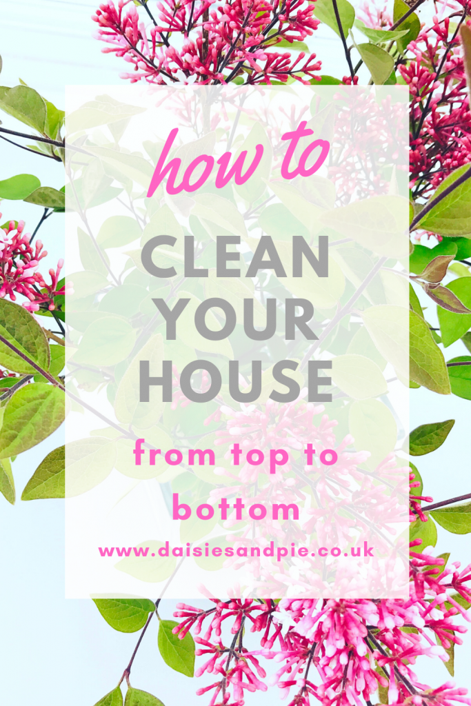 "how to be organized with housework - vase of lilacs. Text overlay ""how to clean your house from top to bottom - www.daisiesandpie.co.uk"""