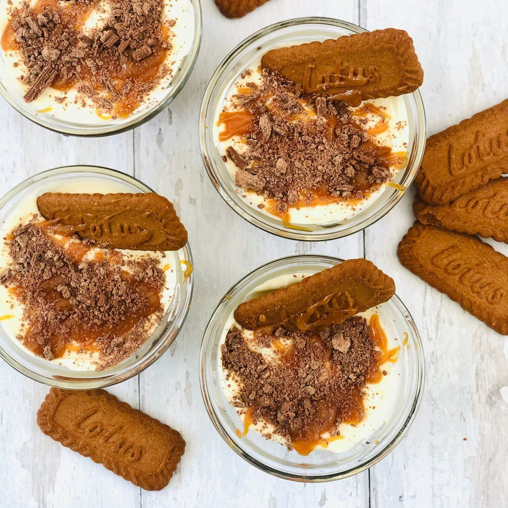 mini no bake biscoff cheesecakes with salted caramel and chocolate toppings