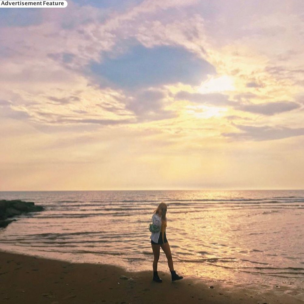 self care routine - girl walking along the beach at sunset