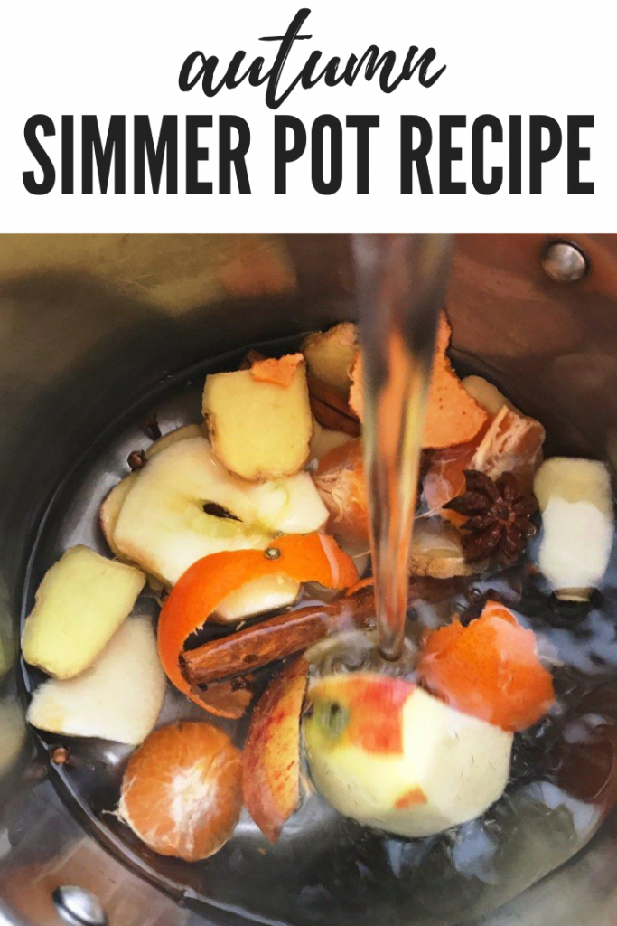"""ingredients for an autumn simmer pot in a saucepan being covered with water. Text """"autumn simmer pot recipe"""""""