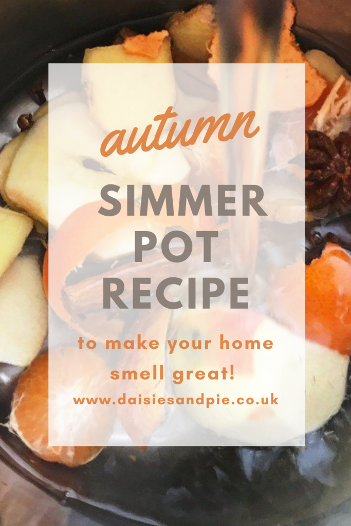"""ingredients for an autumn simmer pot in a saucepan being covered with water. Text """"autumn simmer pot recipe to make your home smell great"""""""