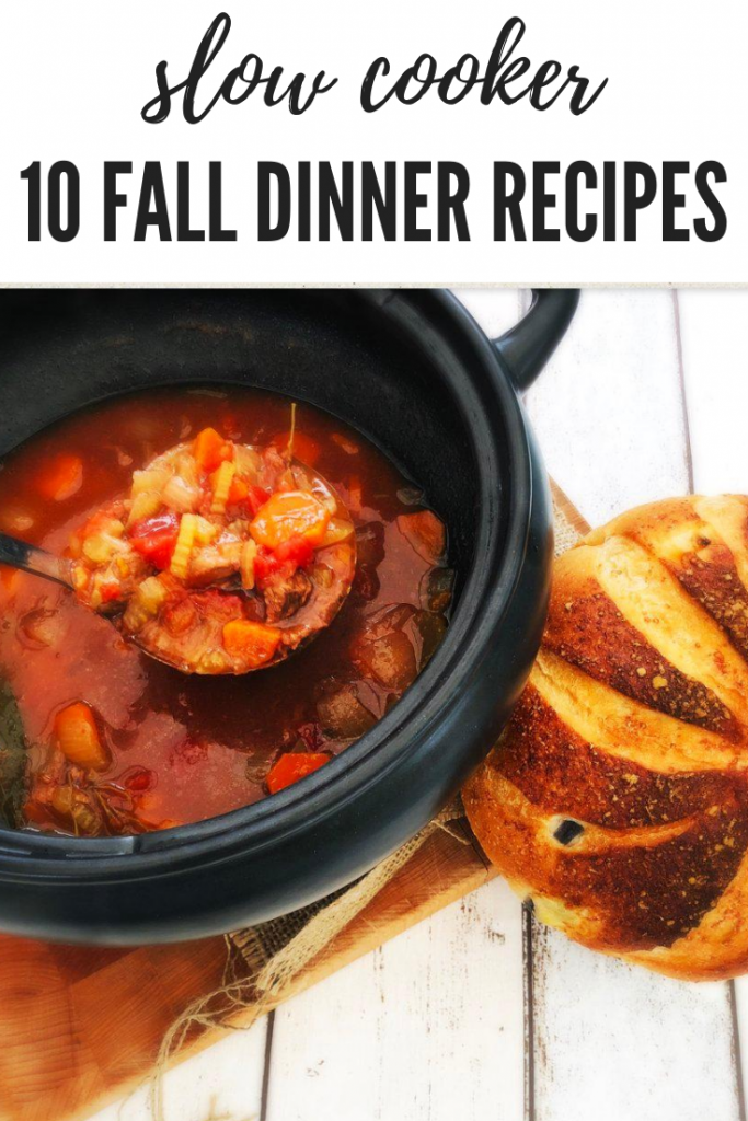 """rustic beef stew being ladled out of the slow cooker. loaf of rustic farm house bread on a board next to the slow cooker pan. Text overlay """"slow cooker 10 fall dinner recipes"""""""