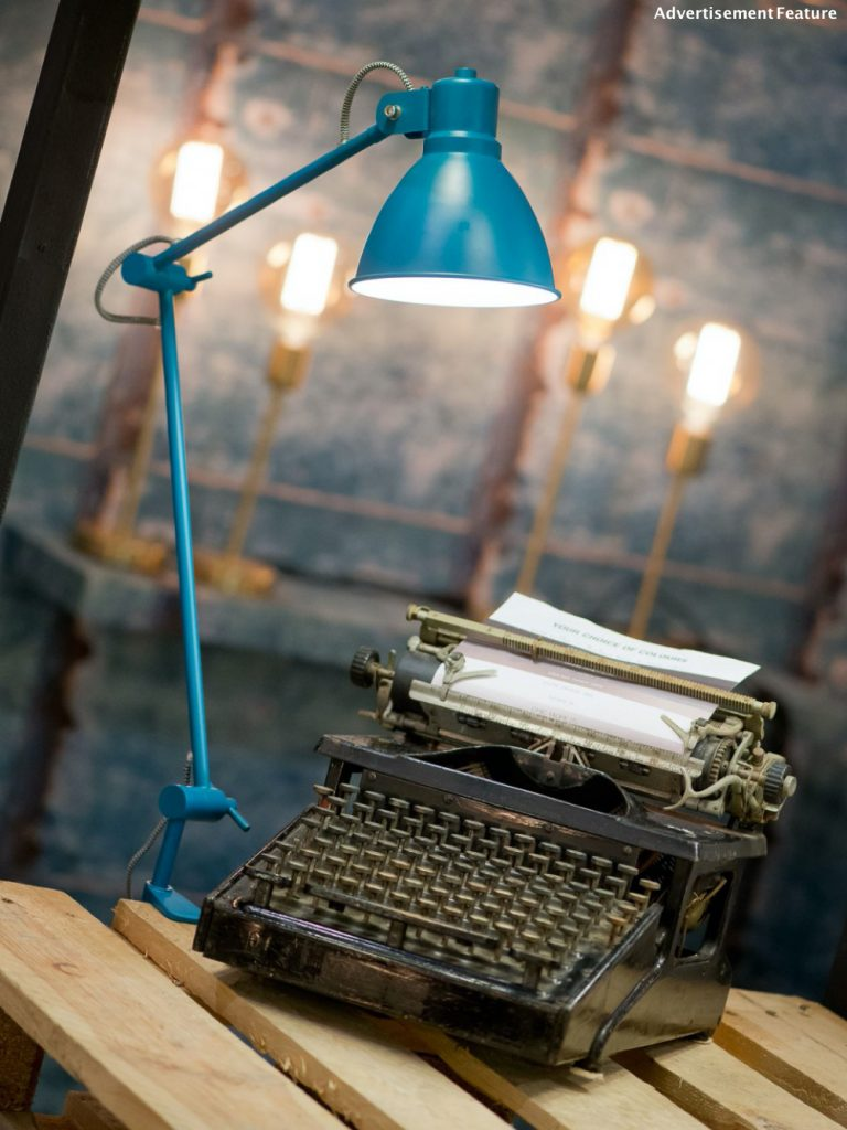 Home office essentials - desk lamp - Derby Clamp Table Lamp in turquoise clamped to a rustic desk next to a vintage typewriter