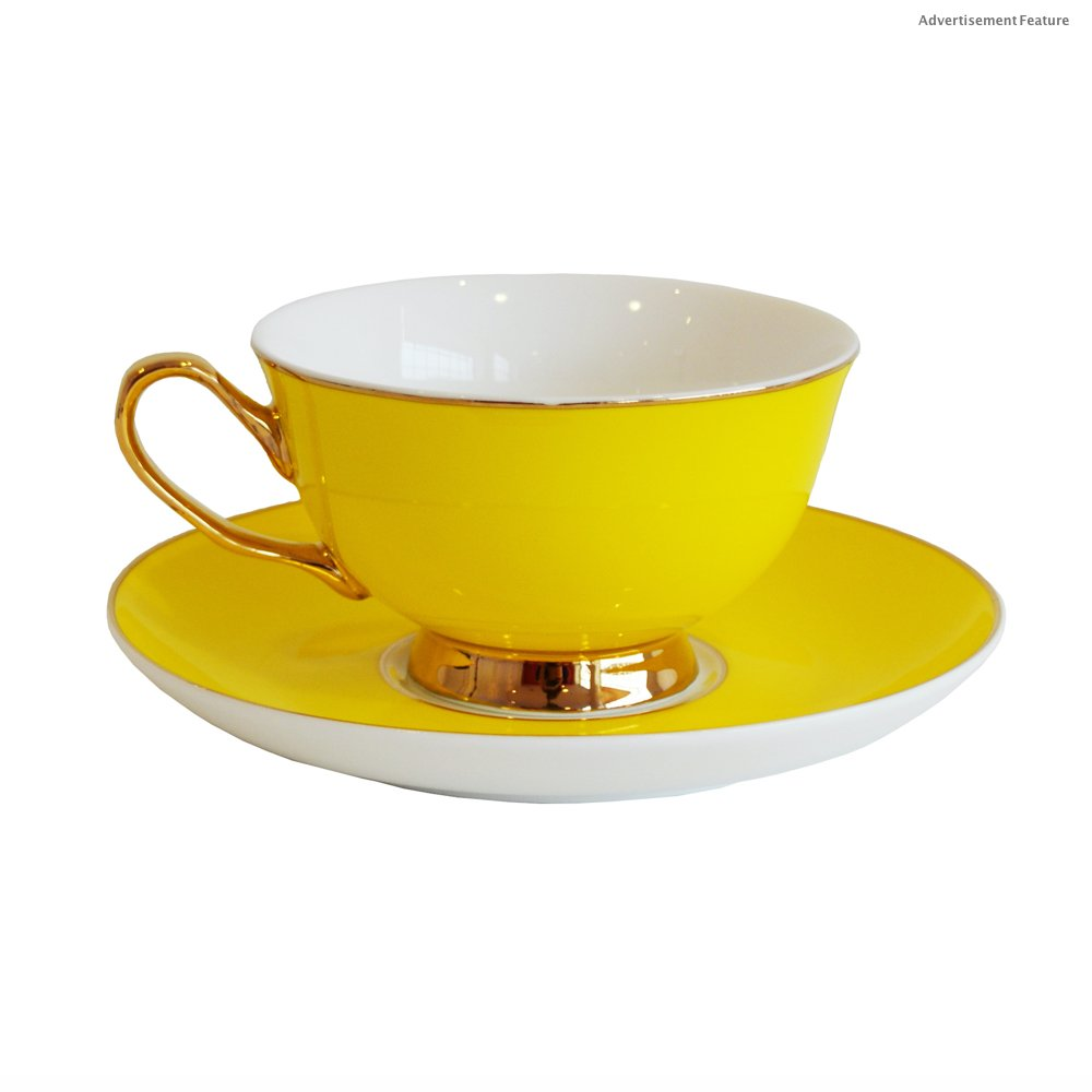 sunshine yellow teacup and saucer with gold handle and rim detail