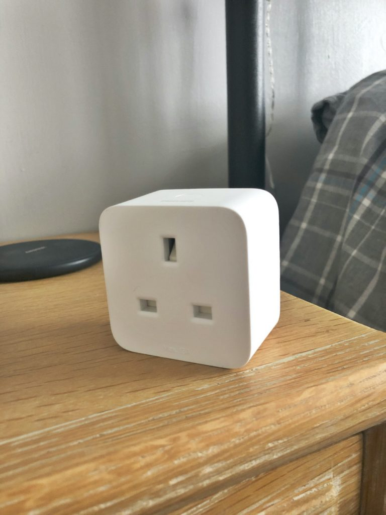 Philips Hue smart plug on a wooden table