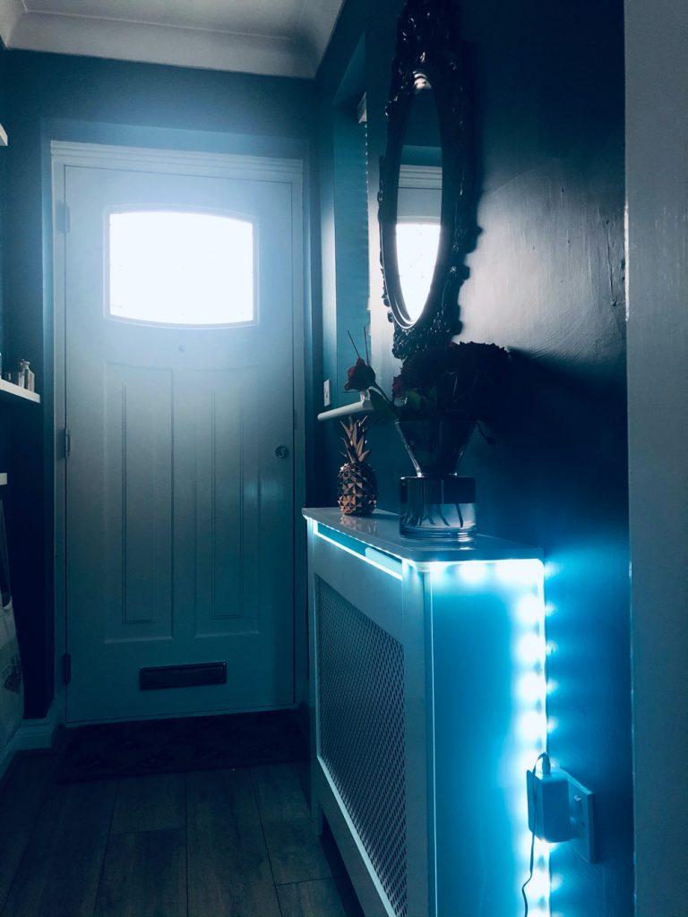 Philips Hue light strip in a hallway emitting blue light