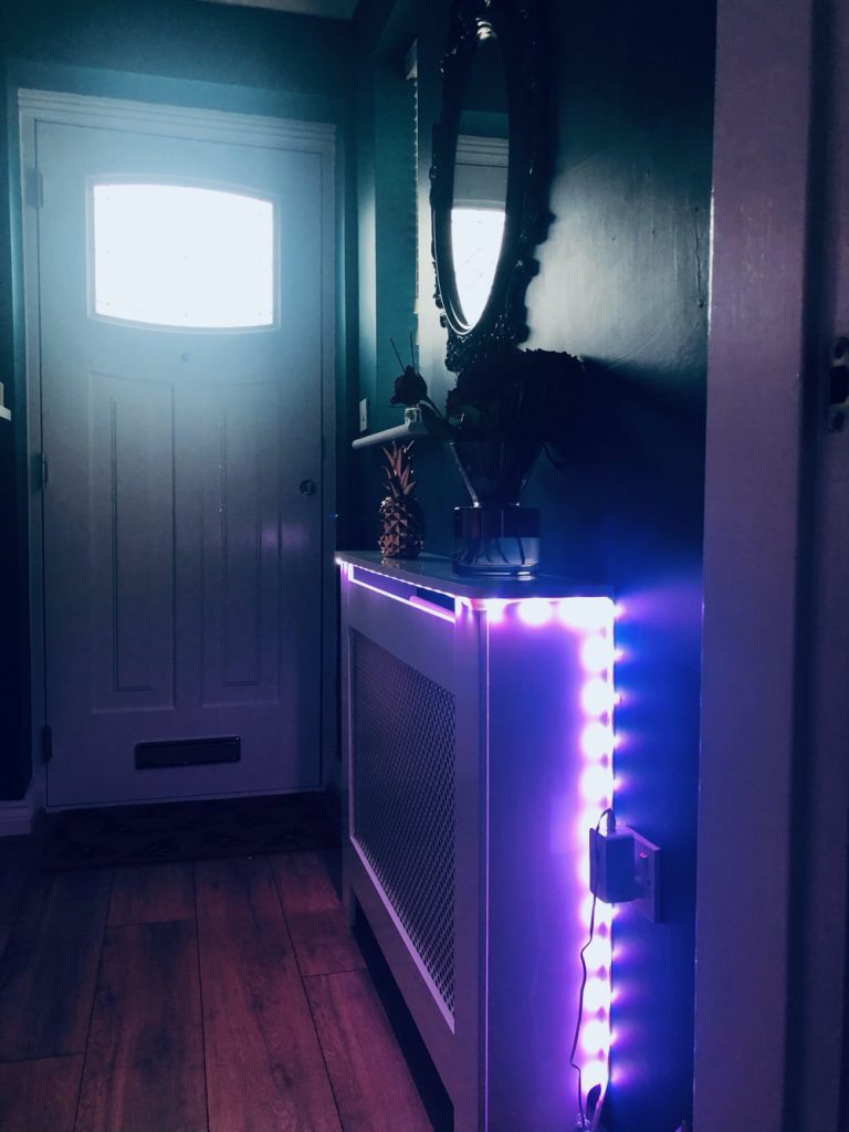 Philips Hue light strip in a hallway emitting lilac light