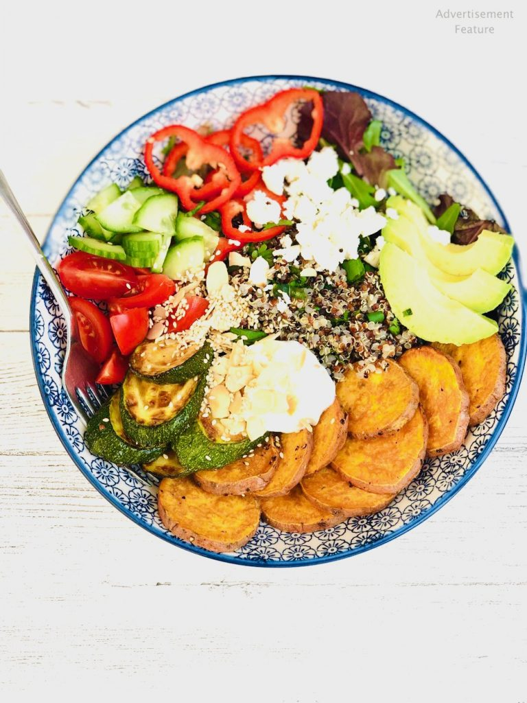 nourish bowls with sweet potato, courgette, peppers, tomatoes, avocado, quinoa, feta cheese and dressing