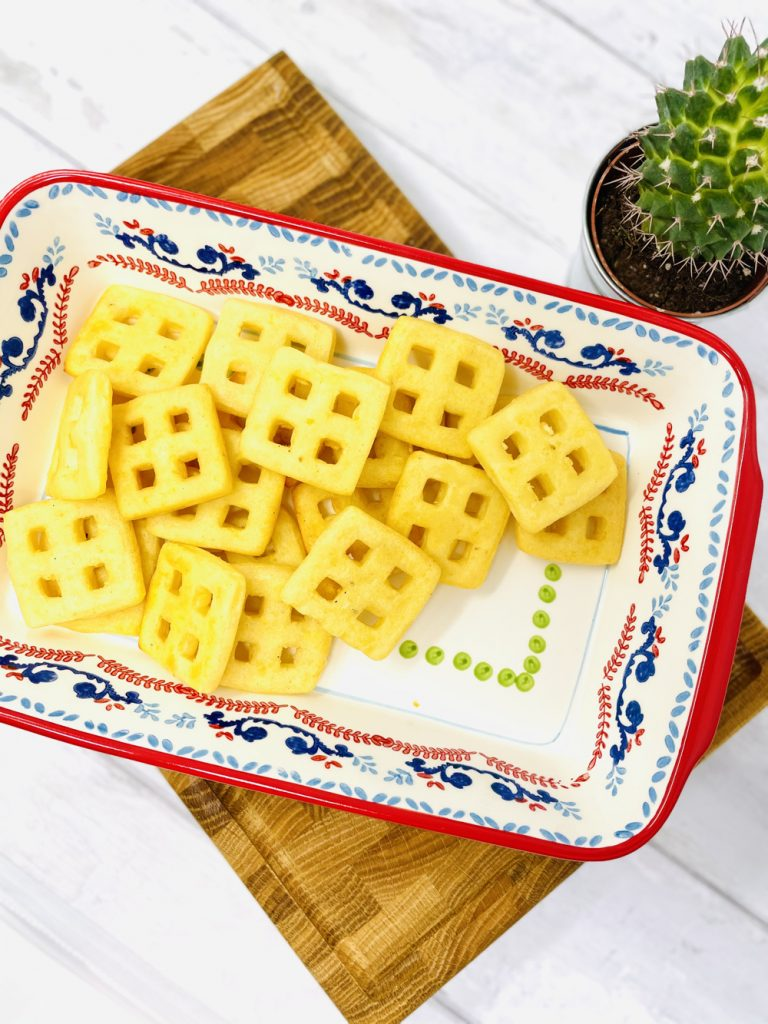 cooked Birds Eye potato waffles in an oven proof serving dish ready to make into waffle nachos