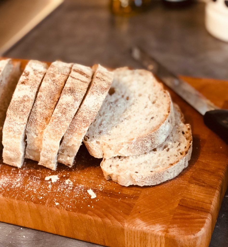 loaf of bread sliced into slices ready to make croutons
