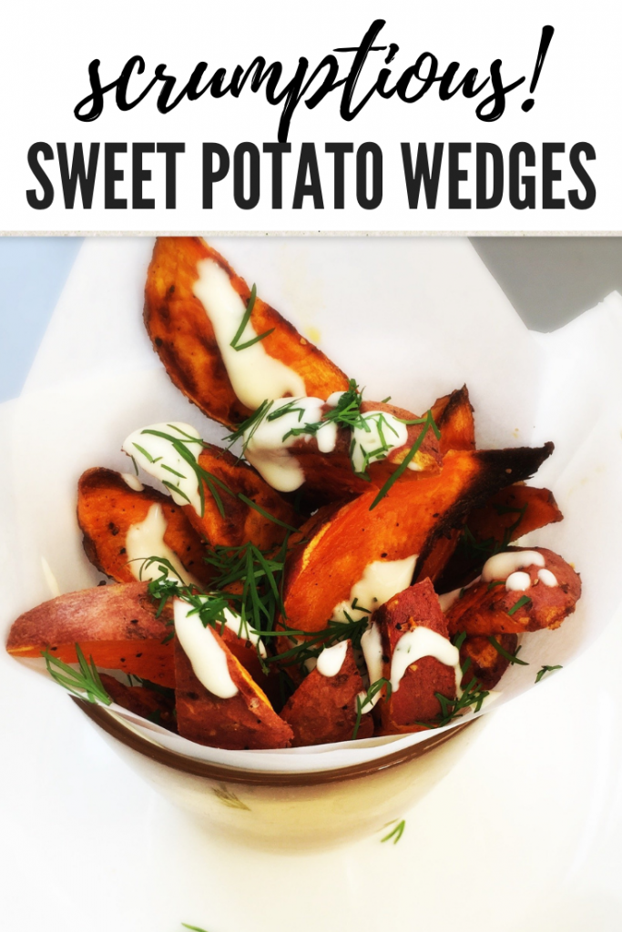 "a paper cone of homemade sweet potato wedges with lemon and herb mayonnaise drizzled over them and chopped dill scattered over. Text overlay ""scrumptious sweet potato wedges"""