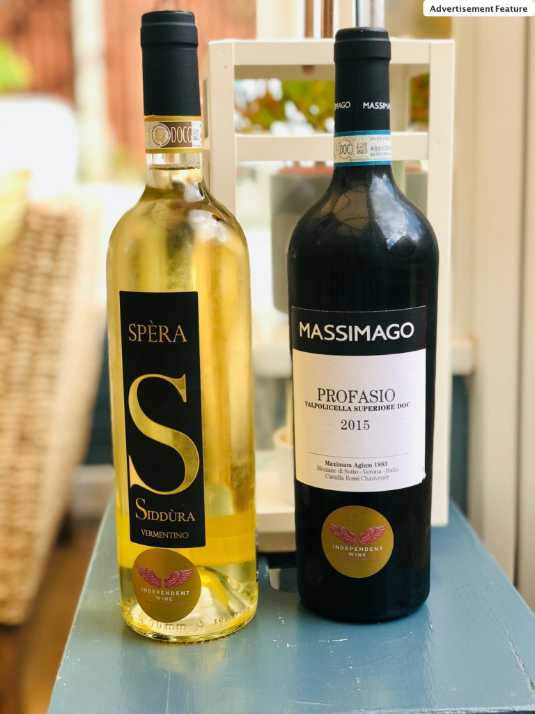 bottle of Siddura Vermentino and bottle of Profasio wine on a grey stool.