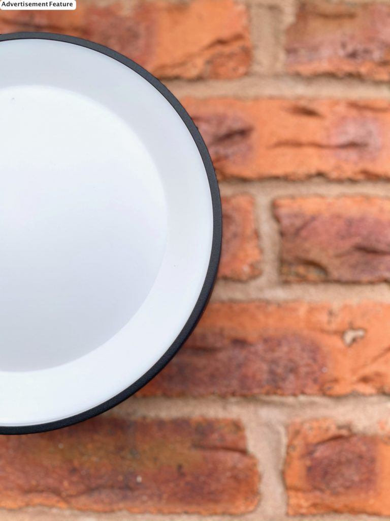 Philips Hue Daylo Outdoor Light against red brick wall
