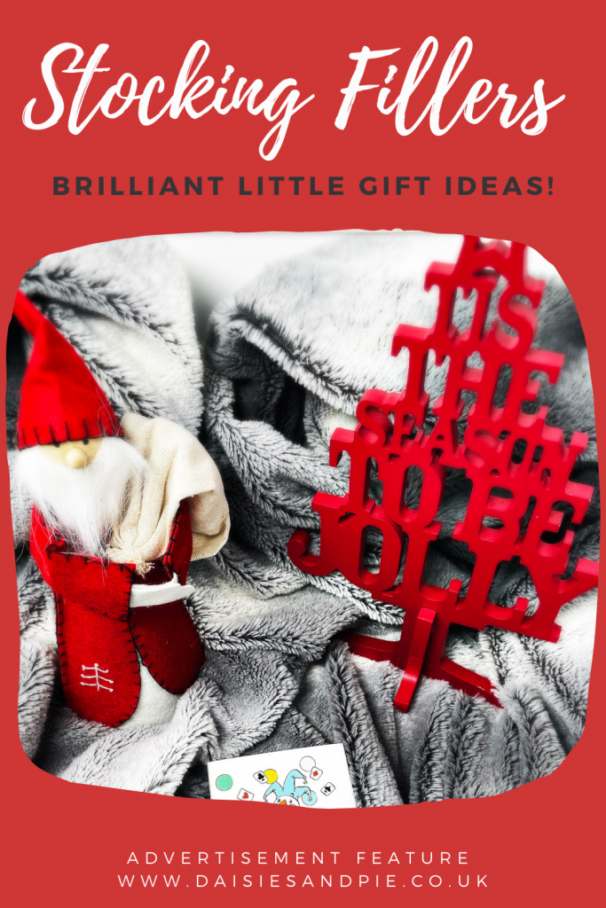 """Nordic Santa Gnome stood by a sign saying """"t'is the season to be jolly"""". Text overlay """"stocking fillers - brilliant little gift ideas"""""""