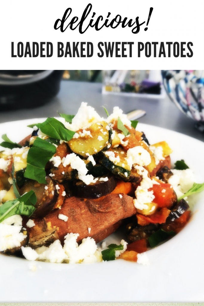 baked sweet potato filled with Mediterranean vegetables marinated in pesto and topped with feta cheese