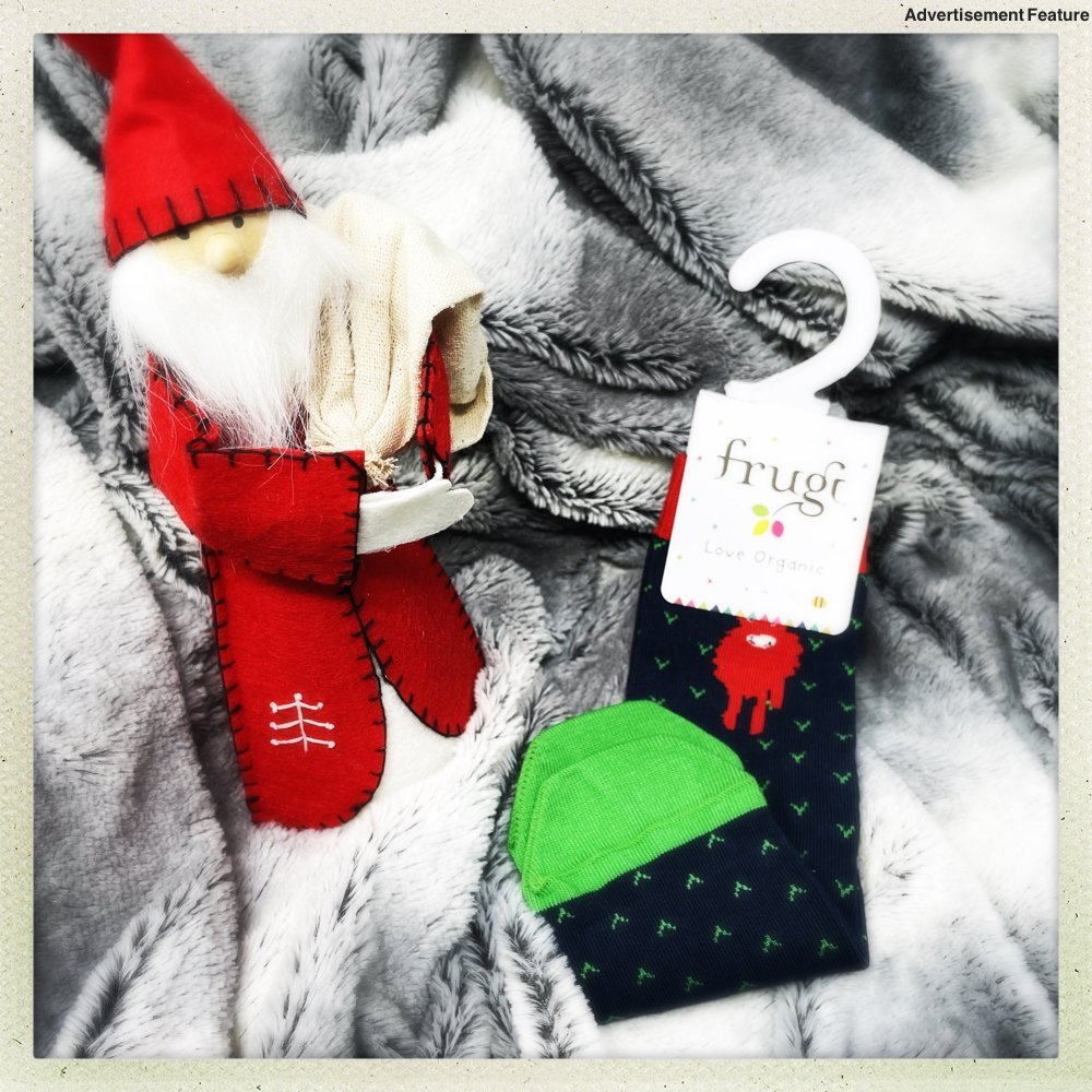 kids socks with a monster on them by a Nordic santa gnome