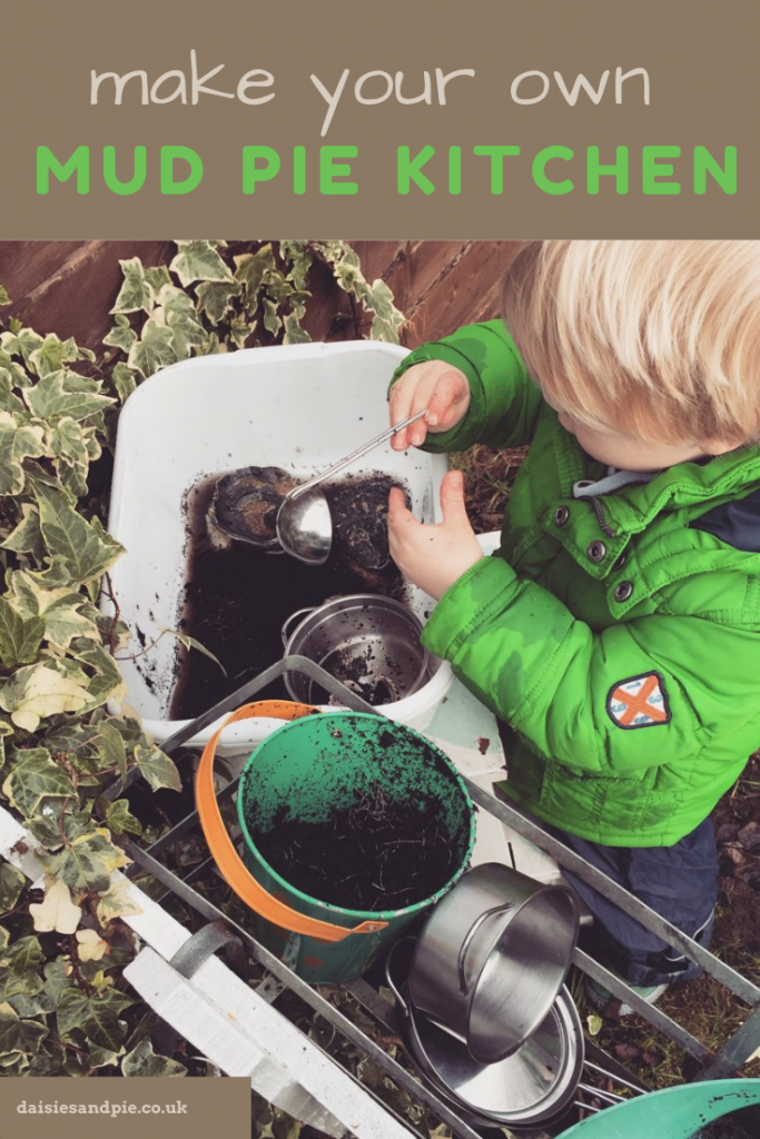"homemade DIY mud pie kitchen made from old pots, pans, jugs and buckets - preschool child mixing up mud pies. Text overlay ""make your own mud pie kitchen"""