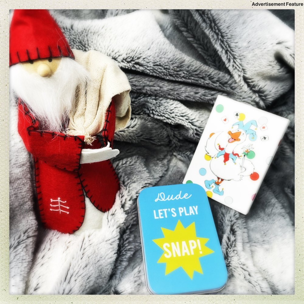 "personalised playing cards for kids - in a gorge tin with personalised message on the front ""Dude Let's Play Snap"" next to a Nordic Santa Gnome"