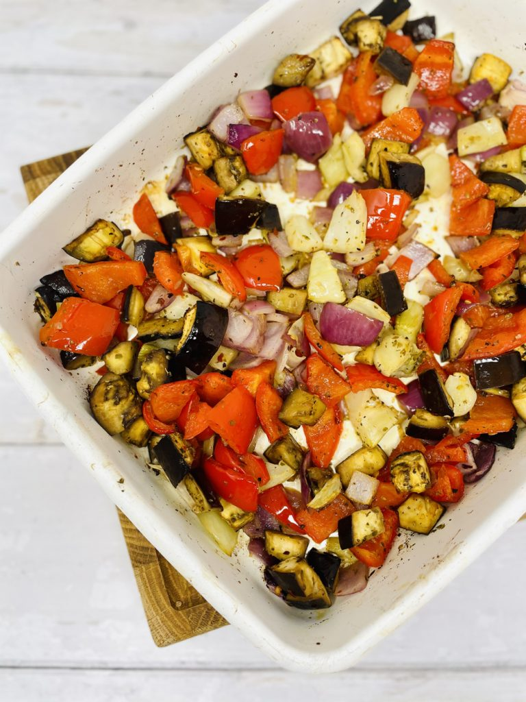 roasted vegetable in an enamel roasting tin ready to make roasted vegetable pasta sauce