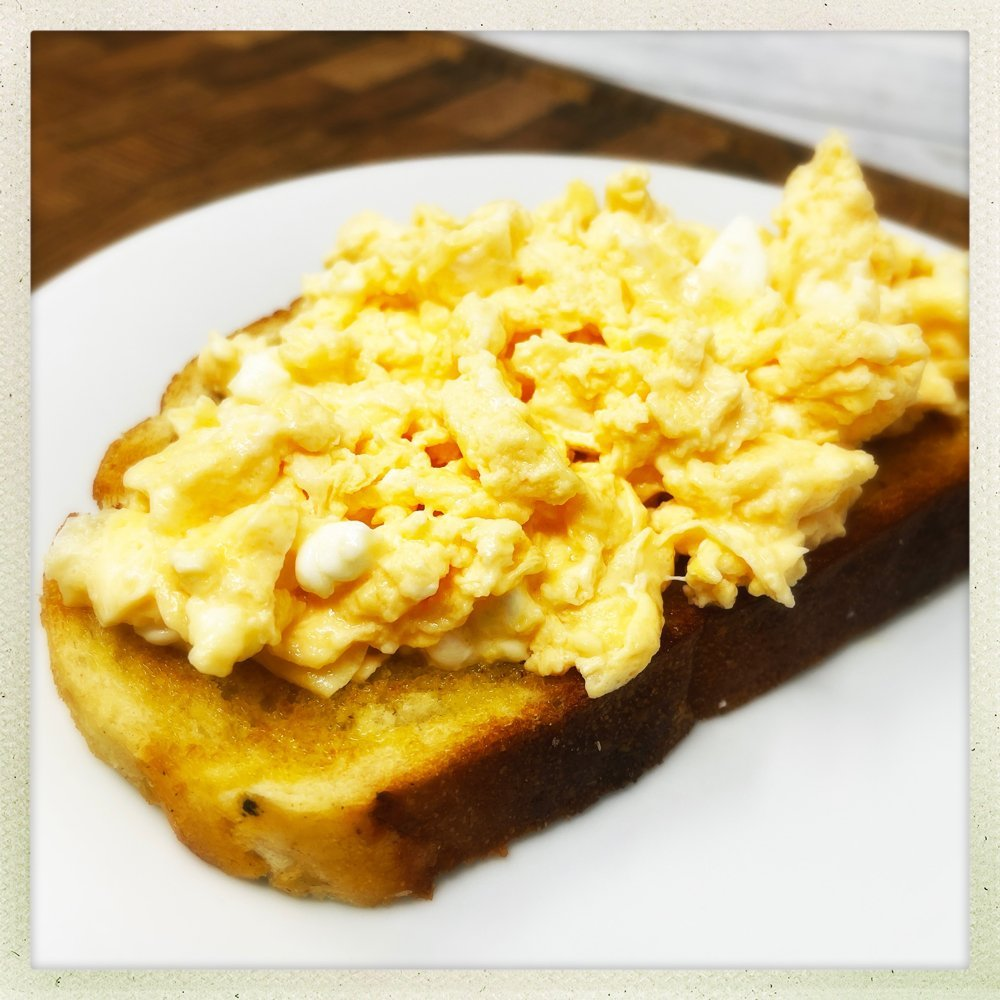 cheesy scrambled eggs with feta on toast