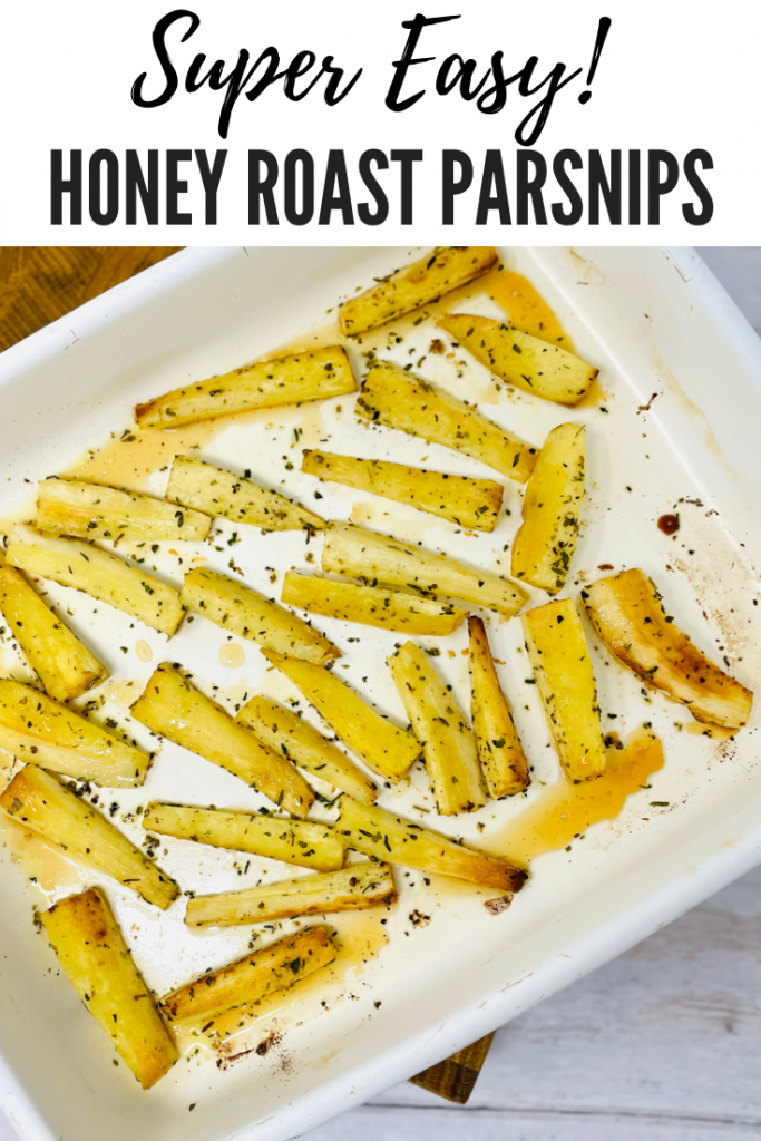 """roast parsnips with honey and herbs in a white enamel roasting tin. Text overlay reads """"super easy honey roast parsnips"""""""